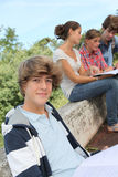 Students with handbooks in school yard royalty free stock photo