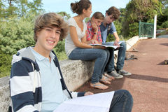 Students with handbooks in school yard royalty free stock photos