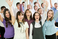 Students with hands raised Stock Images