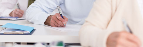 Students hands during writing exam Stock Photography