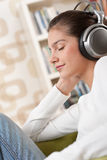 Students - Happy female teenager with headphones Royalty Free Stock Images