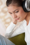 Students - Happy female teenager with headphones Royalty Free Stock Photos