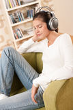 Students - Happy female teenager with headphones Royalty Free Stock Photography