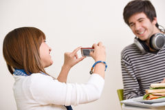 Students - happy teenage couple taking photo Royalty Free Stock Images