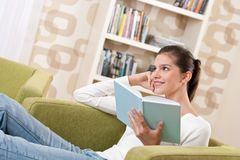 Students - Happy teenager with book Royalty Free Stock Image