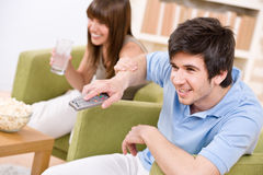 Students - happy teenagers watching television Stock Photos
