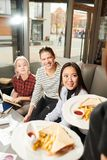 Students have lunch in cafe stock image