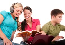 Students having fun, doing home work. Group of students having fun, doing home work (isolated on white Stock Images