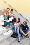 Students having fun with laptop school stairs. Teens college laughing Royalty Free Stock Photos
