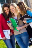 Students having fun with smartphones after class Royalty Free Stock Photo