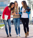 Students having fun with smartphones after class Royalty Free Stock Photos