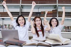 Students having a group meeting in library. Successful female students having a group meeting in library Stock Image