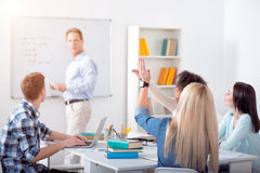 Students having the lesson. I know.  Young intelligent students having the lesson in the classroom Royalty Free Stock Image
