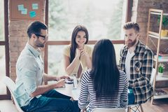 Students having meeting in a cafe and discussing the latest news. Pretty people working together in workstation workplace in spacy royalty free stock photography