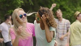 Students having party in park, two beautiful multiracial girls dancing, smiling. Stock footage stock video footage