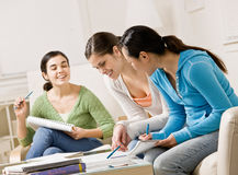 Students helping each other do their homework Stock Photos