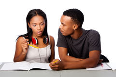 Students helping studying together. Two students happily studying together, on white Royalty Free Stock Images