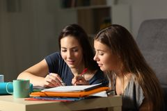 Students helping to learn in the night at home. Students helping to learn each other in the night at home stock images