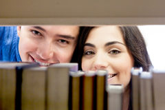 Students hiding at the library Stock Photos