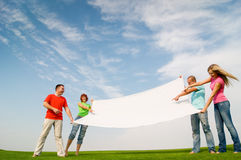 Students holding banner outdoors Royalty Free Stock Photography