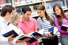 Students holding books Royalty Free Stock Photography