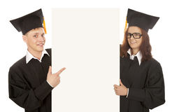Students holding empty banner. Two graduate students holding empty banner Stock Image