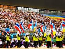 Students holding flags and celebrating Hari Merdeka Royalty Free Stock Photography