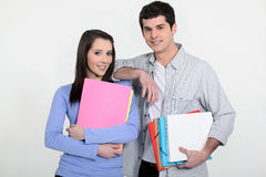 Students holding folders Royalty Free Stock Photo