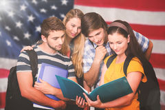 Composite image of students holding folders at college corridor Royalty Free Stock Photography