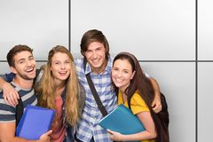 Composite image of students holding folders at college corridor royalty free stock image