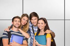 Composite image of students holding folders at college corridor royalty free stock images