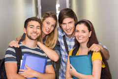 Students holding folders at college corridor Royalty Free Stock Image