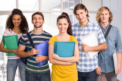 Students holding folders in college Royalty Free Stock Images