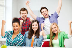 Students holding hands up at school Royalty Free Stock Photos