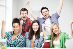 Students holding hands up at school Stock Photography