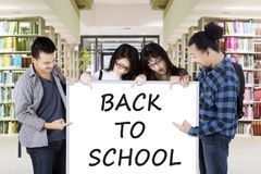 Students holding text of Back to School Royalty Free Stock Photography