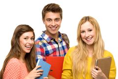 Students holding their books Royalty Free Stock Photos