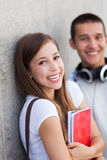 Students holding their books Stock Images