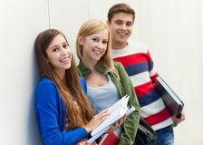 Students holding their books Stock Photos