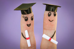 Students holding their diploma after graduation.  Stock Photo