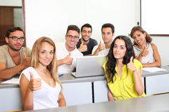 Students holding thumbs up Royalty Free Stock Photo