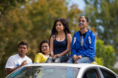 Students during a homecoming parade. CALDWELL, IDAHO/USA - SEPTEMBER 27:Four unidentified students sitting on the top of a car at the Caldwell High School Royalty Free Stock Images