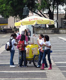 Students and ice cream man Stock Photography
