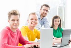 Students at the informatics and programming lesson royalty free stock photos