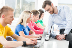 Students at the informatics and programming lesson Stock Image