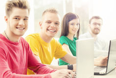 Students at the informatics and programming lesson. Education concept. Hipster color Stock Images