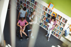 Students interacting with each other in library. At school Stock Images