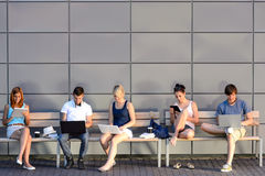 Students internet computer addiction sitting bench Stock Image