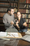 Students Joking in Library Stock Photos