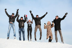 Students jump in winter on to snow Stock Images